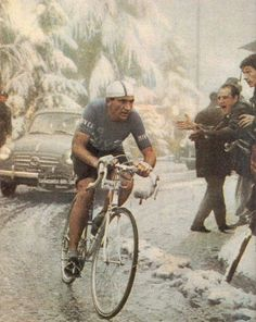 Fiorenzo Magni climbing to second overall on the famous Monte Bondone blizzard stage during the 1956 Giro d'Italia.