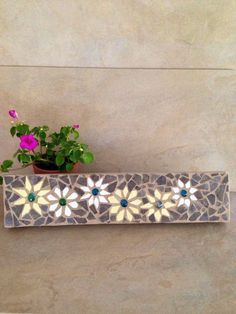 A personal favorite from my Etsy shop https://www.etsy.com/listing/234558066/mosaic-wall-hanging-pallet-art-wall