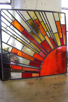 A sunburst stained glass window made by Caroline Channing
