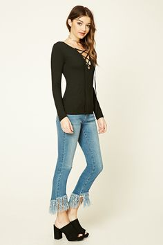 A cotton-blend knit top featuring a plunging lace-up V-neckline and long sleeves.