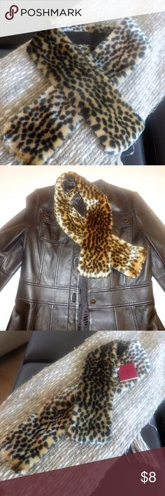 Leopard Print Faux Fur Scarf WOMENS FAUX FUR LEOPARD PRINT SCARF...FROM JAPAN... PRODUCED BY DAITO... NOT SURE OF MATERIAL CONTENT TAGS ARE IN JAPANESE  Instantly update your outfits  A cute alternative to a big scarf on chilly fall evenings  Nice accent with your leather jacket or dress up your jean jacket  Animal prints are trending for Fall 2017  Note:  This Listing is for the scarf only -- Black Jacket is not for sale. Accessories Scarves & Wraps