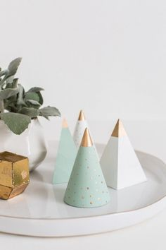 wooden triangle blocks, craft paints of your choice, paint brushes and liquid gold leaf. First, paint each block the colors of your choice for the base and let them dry to the touch.