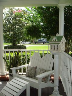 Love front porches.  The birdhouse is a nice touch.