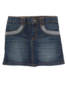 Cool stretch jean skirt with stitched belt loops and denim trim.
