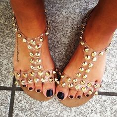 Steve Madden, love how its a flat shoe you can wear with no worries- plus has rad clear straps with spikes