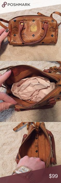Mcm mini Boston bag Awesome little mcm bag, can be crossbody or held by handles. Similar to the LV speedy style, called the Boston mini, preloved condition with lots of life left! MCM Bags Crossbody Bags