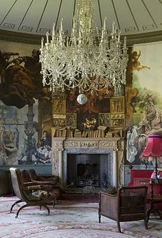 this chandelier is gorgeous! What a cool room too!