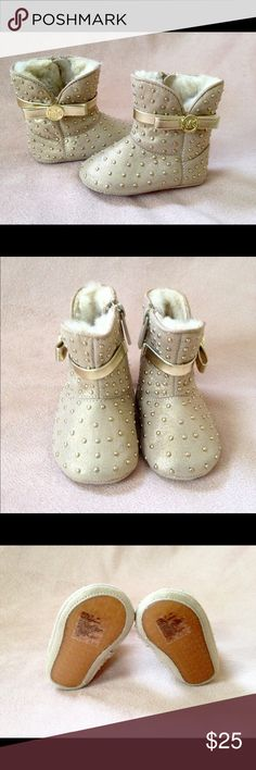 Authentic Michael Kors Baby Girl boots These Michael Kors boots have NEVER been worn. They are darling, lined with soft fur and zip up on the sides. Michael Kors Shoes Boots