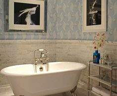 Pale blue wallpaper in the bathroom with freestanding tub