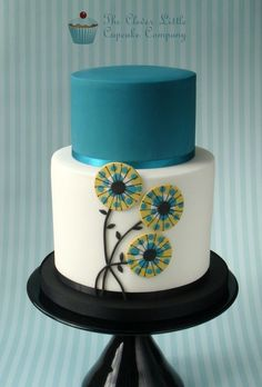 Teal Wedding Cake - Round Wedding Cakes by Cake Central. Extended height bottom tier with stylised flowers and complimenting top tier.