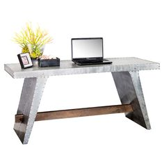 $499 Aluminum desk with studded detail and wood stretcher.   Product: DeskConstruction Material: Aluminum and wood...