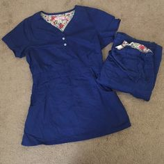 Royal Blue scrubs Royal blue scrubs, short sleeve top with matching bottoms. Both size small. Elastic band around middle of top, elastic band around waist of pants. Both pieces have pockets. Slight wear at very bottom of pants where they hit the floor. Koi brand Koi Other