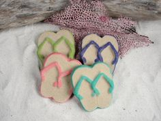 Hey, I found this really awesome Etsy listing at http://www.etsy.com/listing/156615654/flip-flop-sand-ornament-favors-beach