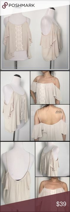 """LAST ONE- Large. : Cold shoulder asymmetrical top ➖SIZE: Large  ➖Large: the bust area isn't very relevant due to the style    ➖LENGTH: 24""""-26"""" ➖STYLE: This bohochic top has an off the shoulder / cold shoulder top also has a loose batwing fit as well as a sharkbite hem. The muddle features a crochet design. This top is perfect for the summer, spring or even fall.  ❌NO TRADE Tops Tees - Short Sleeve"""