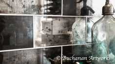 Reflection of our hand silvered mercury glass tile finish....I have moved my website and changed my company name.  Michele Buchanan Studios is now at www.michelebuchanan.com