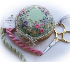 Wow! This pincushion is ridiculously ornate and beautiful! I feel that if I made that, I would never pin cushions to it. It would be more of a chachki. LOL  Sunshine and Flowers Pincushion Kit by lornabateman22 on Etsy, $49.95