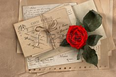 dry red rose and old love letters  vintage postcards and envelopes, vintage valentines day