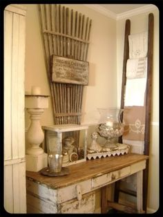 I like the use of garden instruments to decorate with. Also the ladder to display linens.