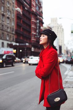 LOCATION: NEW YORK J Brand Leather Pants / Nicholas Coat / Charlotte Olympia Boots / Mulberry Bag /  Eugina Kim Hat