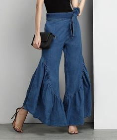 These pants put a fresh, feminine spin on classic bell-bottoms with a tie waist and ruffly flared hems. Soft cotton-blend chambray with a hint of stretch provides all-day comfort.Made for zulilyModel: 5' 8'' tall; 33'' bust; 24'' waist; 35'' hipsSize S: 30'' inseamWoven76% cotton / 22.5% polyester / 1.5% spandexMachine wash; hang dryImportedShipping note: Allow extra time for your special find to ship.