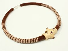 """by Linda Magi - """"Twig Cylinder Necklace"""" from the """"of a Place - Muskoka"""" collection, Canadian Maple Twig, crocheted cotton, fine silver, argentium silver, garnets, tiger eye"""