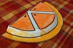 draw orange slice outlines in sharpie, kids paint with orange watercolors for orange day