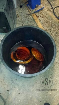 Bowls Soaking in a Bucket of Denatured Alcohol