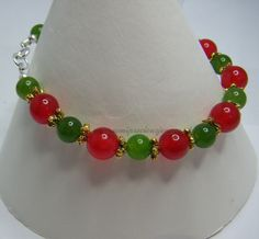 Red & Sage Green Quartzite with Gold Coloured Flower Spacers  £12.20 plus p&p www.semipreciousjens.co.uk
