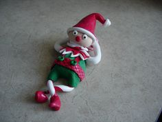 lutin relax. Elf relaxing on a big candy