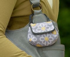 so cute! pacifier pods that clip to the outside of diaper bag so you don't have to dig around for it!