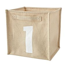 Shop Toy Storage Bins: Alphanumeric A1.  We're not sure what we like best about this Alphanumeric Cube Bin.  Maybe it's the screen printed graphics and natural jute construction.  Or perhaps it's the way it can hold plenty of toys and games.