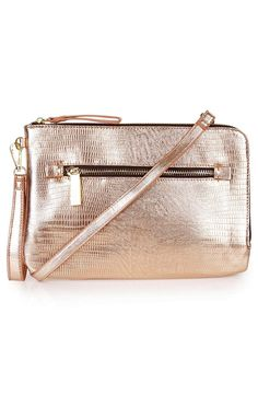 A duo of handy straps allows for switching between carrying this shiny rose gold snake-stamped clutch or wearing it as a sleek crossbody bag.