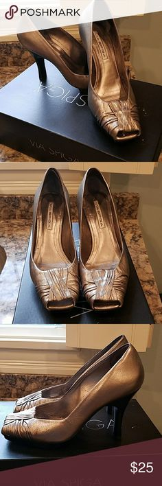 Via Spiga heels. This ia a beautiful pr of pewter colored open toe platform heels.  They have a black platform and heel and in excellent condition they do fit more like an 8 Via Spiga Shoes Heels