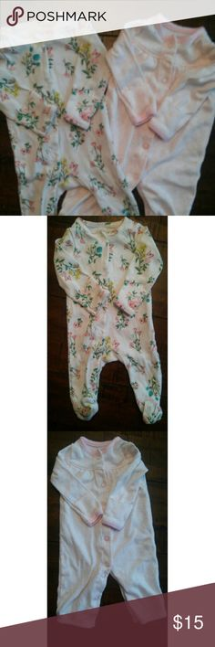 Lot of 2 Baby Girl Floral and Pink Sleepers Very cute and girly set of two girl's button up sleepers.   Worn once, excellent condition! Carter's One Pieces Footies
