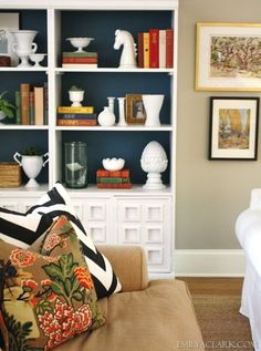 navy blue backed bookcases  -- so elegant -- and with Chic Shelf Paper, get each piece cut-to-size; all you have to do is peel and stick to install!