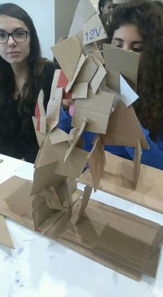 Building challenge using cardboard and an exacto knife.