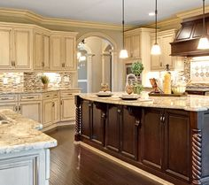 Island different color than cabinets. Stove hood same as island