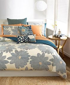 Matches the wall paper and with bright sheets can be a nice option to have bright/bold accents still