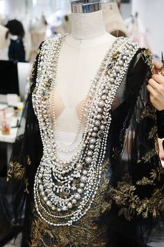 Hand stitching in the Marchesa atelier