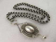 Very striking  English Victorian sterling silver locket and collar set, $395