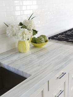 Luce Di Luna quartzite + white subway tile