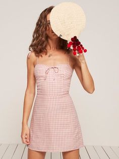 You probably need a new dress. This is a mini length, fit and flare dress with a center front tie and a sweetheart neckline.