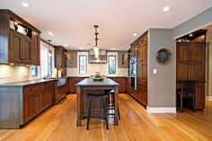 White Oak wide plank flooring anchors this Craftsman-style home in Chicago. The floors feature an oil based poly finish and the planks are a solid thickness and range from 7 to 9 inches wide. Layout Design, Wood Design, Wide Plank Flooring, Planks, Planer Layout, Wood Floor Kitchen, Wood Stain Colors, Loft, White Oak