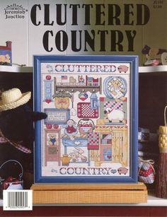 Schema punto croce Cluttered Country 01