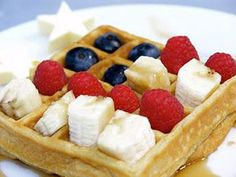 20 American Flag-Themed Foods to Salute (Then Eat!) | WAFFLE | A waffle's signature squares are usually reserved for melted butter and maple syrup, but on July 4 fill them with a patriotic-colored fruit trio – strawberries, blueberries and bananas. Drizzle maple syrup over the top for a sweet start to your day.Get the Recipe HERE.