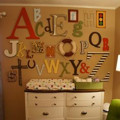 Assign each guest a letter and ask them to bring that letter decorated for the nursery. Or ask them to bring a plain one & decorate at the shower, that way you control the colors/theme.