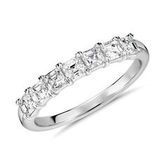 Asscher cut diamonds make a chic and elegant statement and this 18k white gold anniversary ring is no exception.