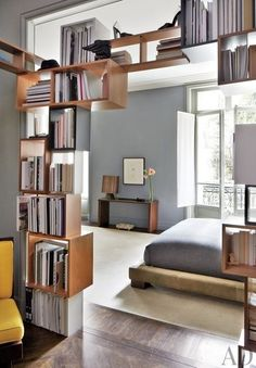 Now that you're older and wiser, consider displaying all of those reading materials that helped you get to where you are today. A bookshelf is the obvious answer, but there are a plethora of other ways to show off a growing library that will benefit to your home decor as well | archdigest.com