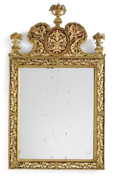 A fine Swedish Baroque gilt-lead and verre-églomisé mirror first quarter 18th century, attributed to Burchard or Gustav Precht with a rectangular mirror plate, the frame and shaped cresting decorated with meandering foliate motifs and flowerheads in gilt on a red ground, fitted at each corner and centered by flower-filled urns; the frame fitted at each corner and centered by gilt-lead clasps. height 55 in.; width 31 in. 140 cm; 79 cm