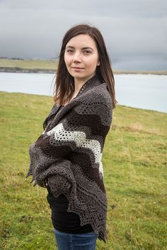 Not every Shetland shawl is made from fine yarn and can pass through a wedding ring. Shetland's weather can be rough, and the practical Shetlanders know that thick wool offers protection from wind and rain. The traditional hap shawl is called for when one's needs turn from lace to warmth.